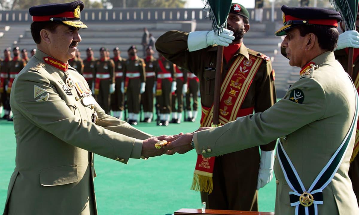 General Ashfaq Parvez Kayani hands over a ceremonial baton to his successor General Raheel Sharif  | AFP