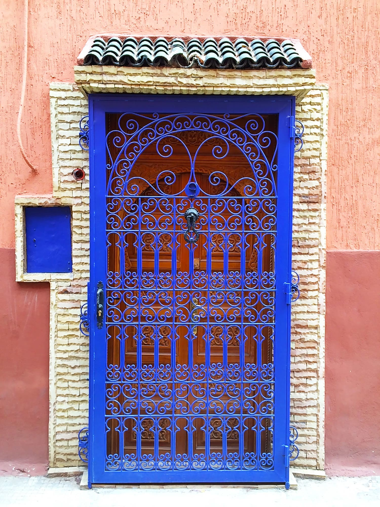 A colourful door in an alley.