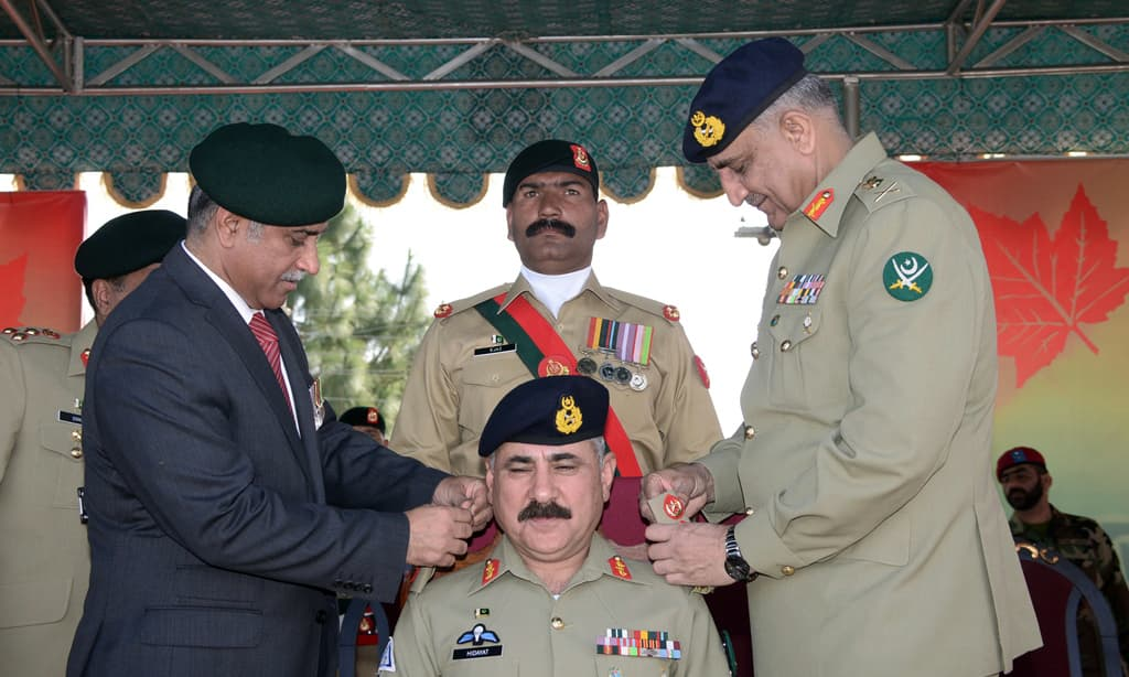 Gen Bajwa and Lt Gen (retd) Ashfaq Nadeem pinned the badges of the rank on Lt Gen Hidayat ur Rehman. —Photo ISPR