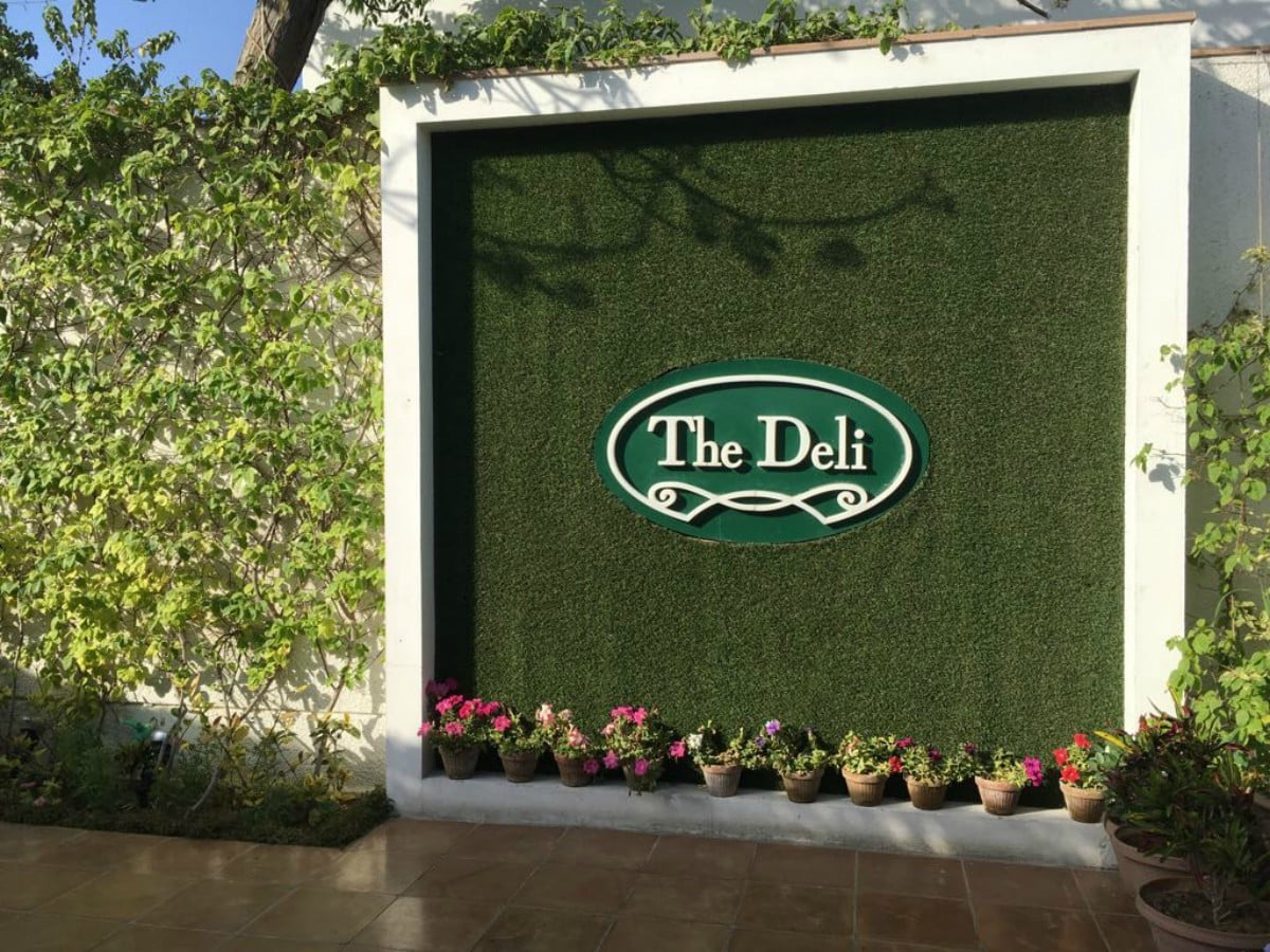 The Deli's sign is simple yet intricate