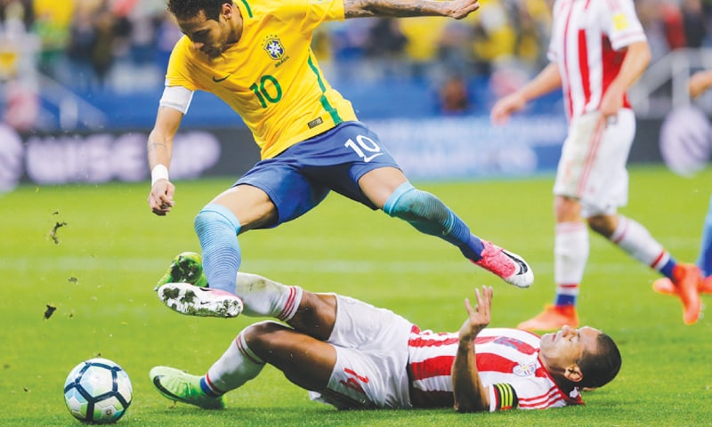 SAO PAULO: Brazil's Neymar evades a tackle from Paraguay's Paulo Da Silva during their 2018 World Cup qualifier at the Arena Corinthians.—AP