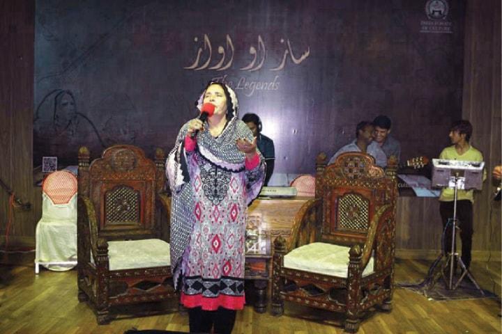 Pashto folk singer Gul Meena Bibi performs at the music concert. — Dawn