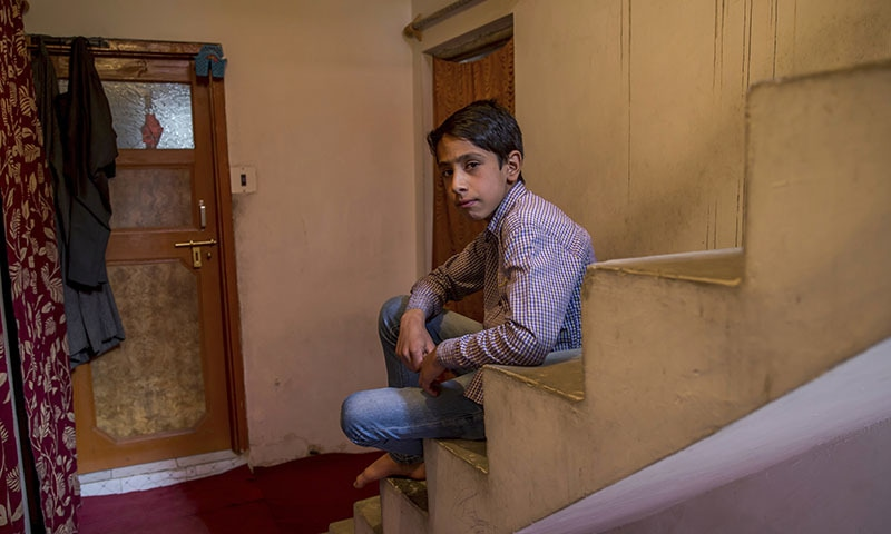 Mir Mehran, 11, a Kashmiri boy who was forced by Indian paramilitary soldiers to perform sit-up while holding his ear lobes, poses for a portrait at his home in Srinagar, Indian-controlled Kashmir. —AP