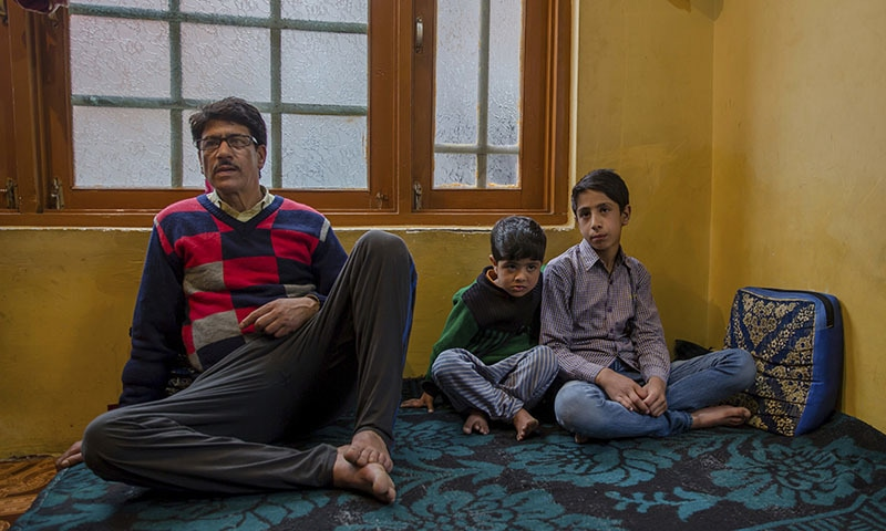 Mir Mehran sits with his cousin Saiba Mir and his father Mohammed Qayoom Mir during an interview with The Associated Press at his home in Srinagar, Indian-controlled Kashmir. —AP