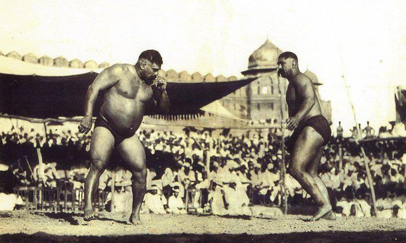 Archival photograph of a wrestling match featuring Gama Pehlwan (left), circa unknown