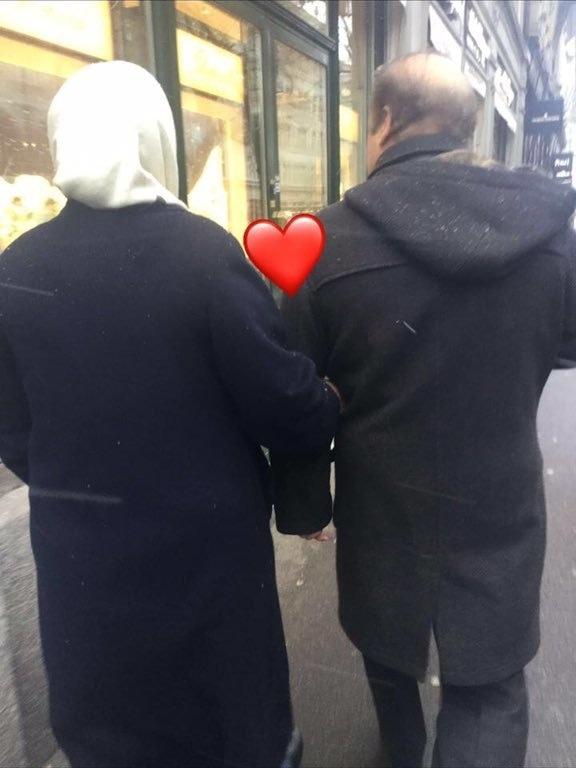 Nawaz Sharif and Kulsoom Nawaz walking down a street arm in arm. ─ Photo courtesy Maryam Nawaz official Twitter