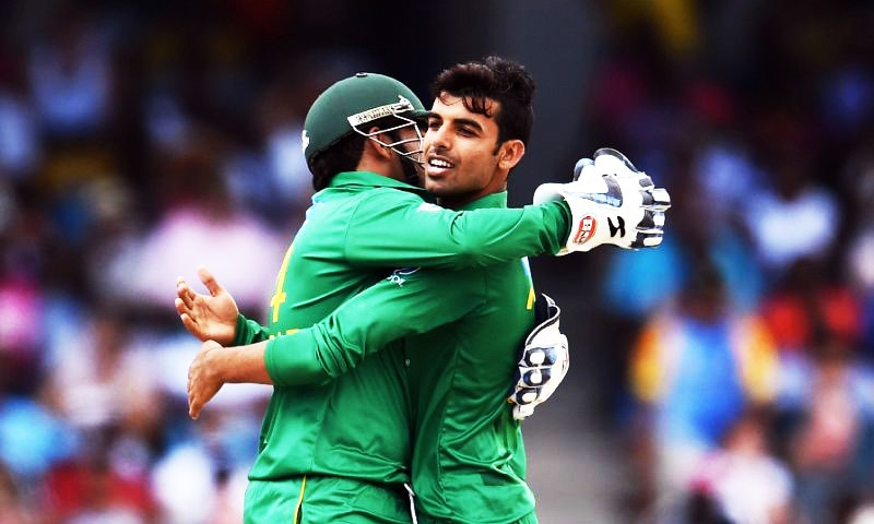 Shadab Khan celebrates with Sarfraz Ahmed after dismissing West Indies' Sunil Narine.—AFP/File