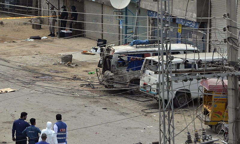 A forensic team arrives at the scene of the suicide bomb attack.— AFP