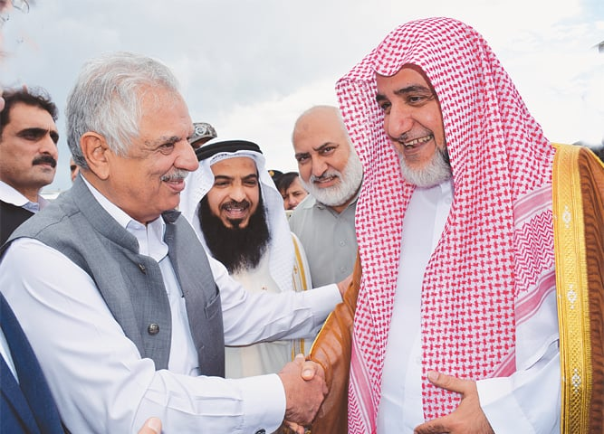 KHYBER Pakhtunkhwa Governor Iqbal Zafar Jhagra receives Imam-i-Kaaba Saleh bin Ibrahim at Peshawar's Bacha Khan airport on Thursday.—INP
