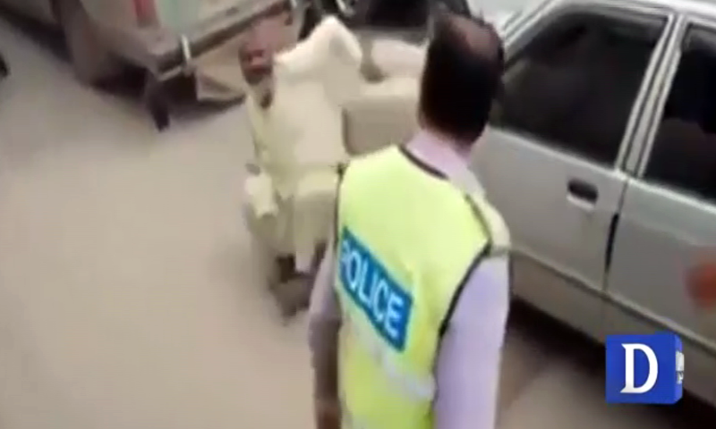 Traffic warden sacked for manhandling elderly man in Nowshera
