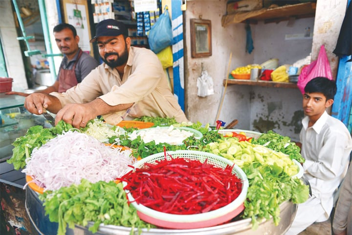 Abdul Waheed at his salad stall in Saddar. -Photos by Fahim Siddiqi / White Star