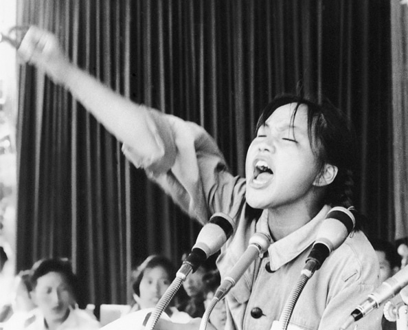 In this photo dated Aug 10, 1966, a young woman calls to embolden her fellow Red Guards in Beijing's Tiananmen Square | AP