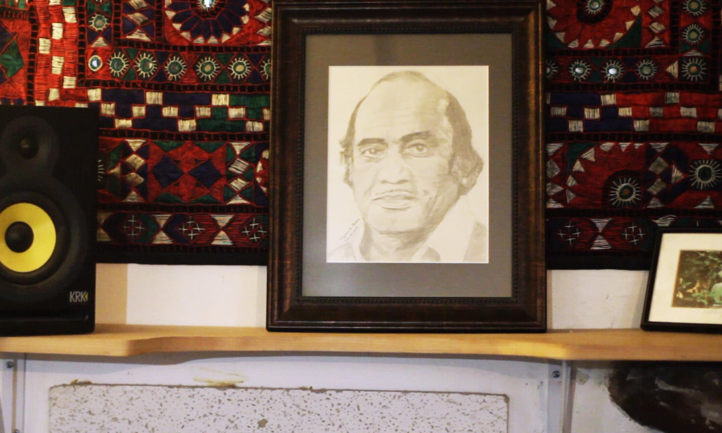 A sketch of Mehdi Hassan prominently placed at Eric's studio. — Photo by Hussain Afzal