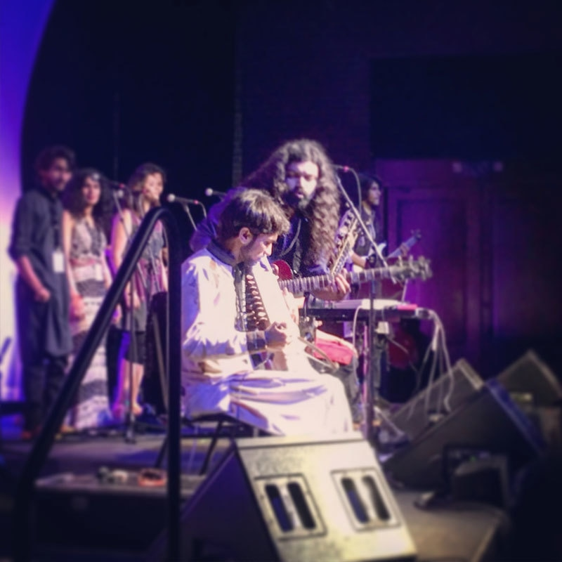 Ahsan Bari encouraging Gul Mohammad on the Sarangi during their performance at the Savannah Music Festival.
