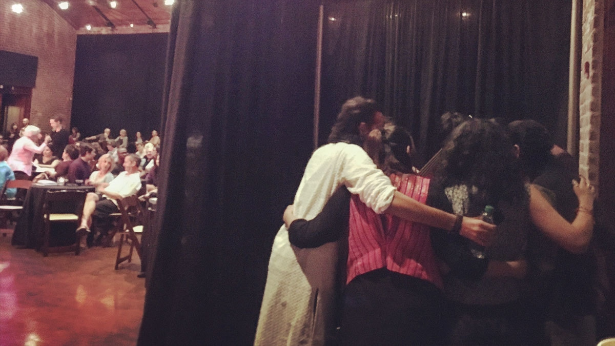 The band huddles together for a massive group hug + prayer before their first performance at the Savannah Music Festival .