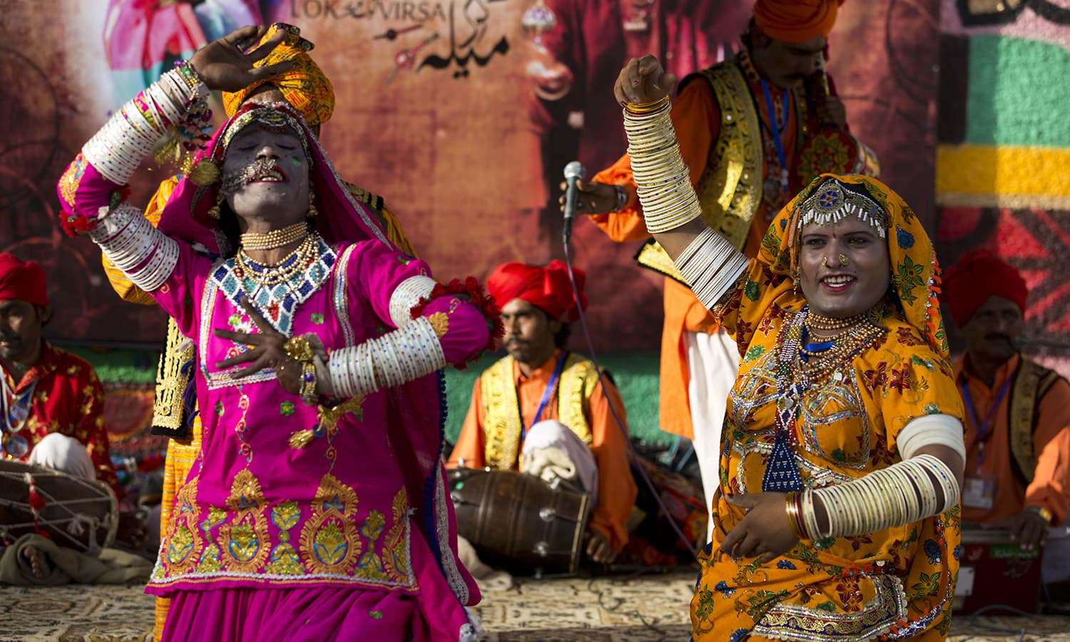 Folk artists, who are eunuchs and street performers belonging to the minority Hindu Bheel community, perform at the festival. ─ AP