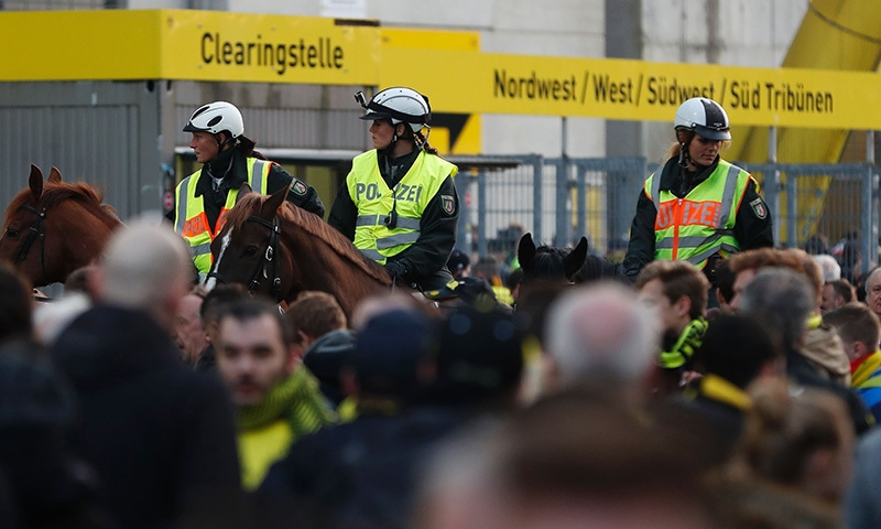 Police patrol on horseback outside the stadium. —AFP
