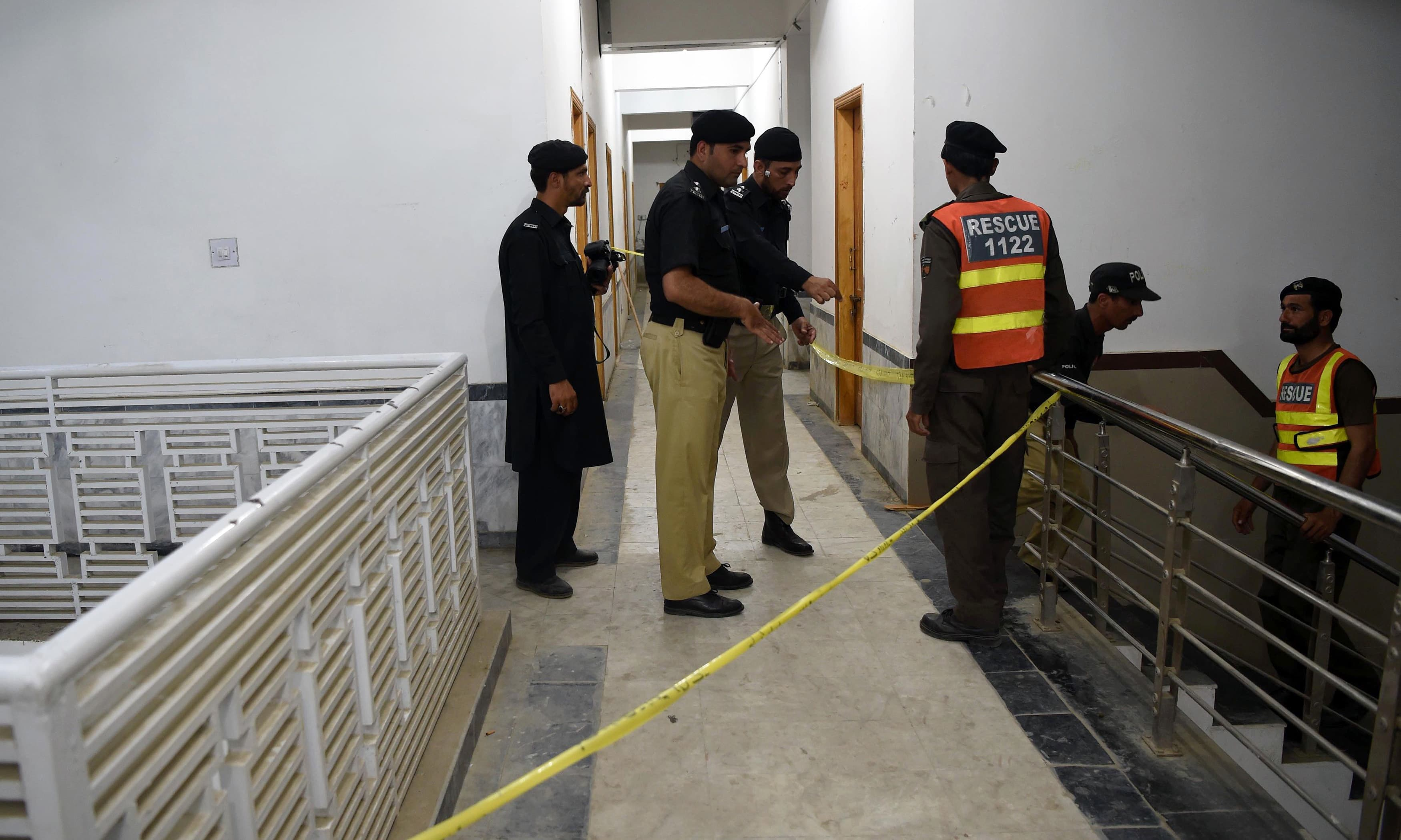 Police inspect the hostel where students beat to death a classmate.—AFP