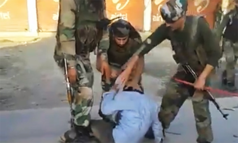 Screen shot shows Indian paramilitary troopers beat Kashmiri man.—Screen grab