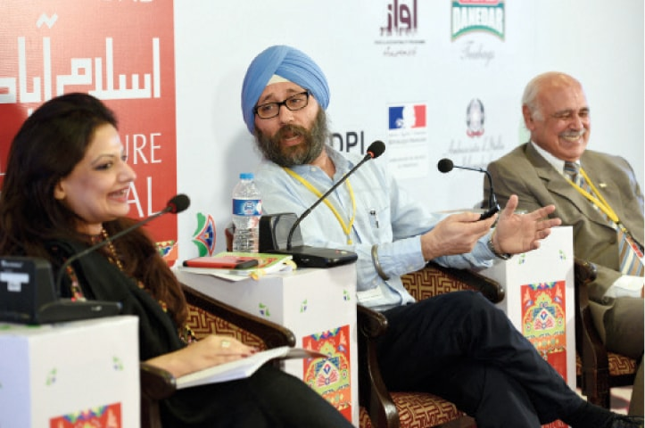 Amardeep Singh speaks at the launch of his book Lost Heritage: The Sikh Legacy in Pakistan on Saturday. F.S. Aijazuddin and moderator Reema Abbasi are also seen. — White Star