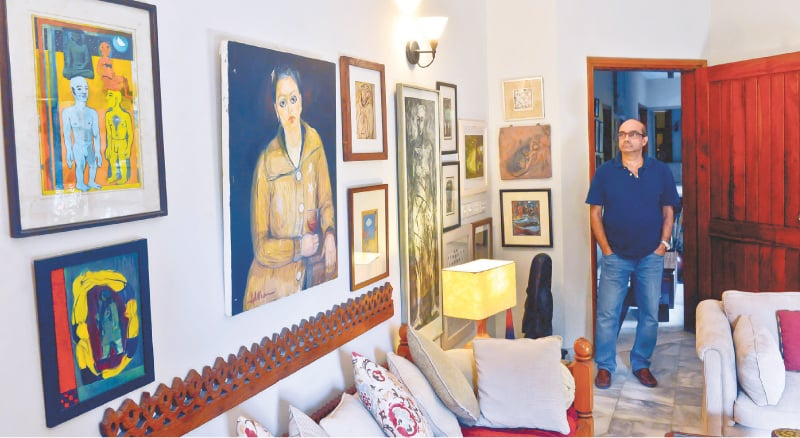 Moeen Faruqi with his collection: a central figure by Iqbal Hussain, a large figurative etching by Naiza Khan, an Anwar Saeed painting among others. - Photos by Fahim Siddiqi / White Star