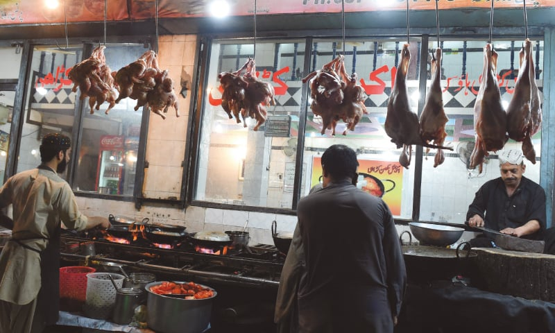 Chicken and mutton hang from hooks, ready to be transformed into mouthwatering foods