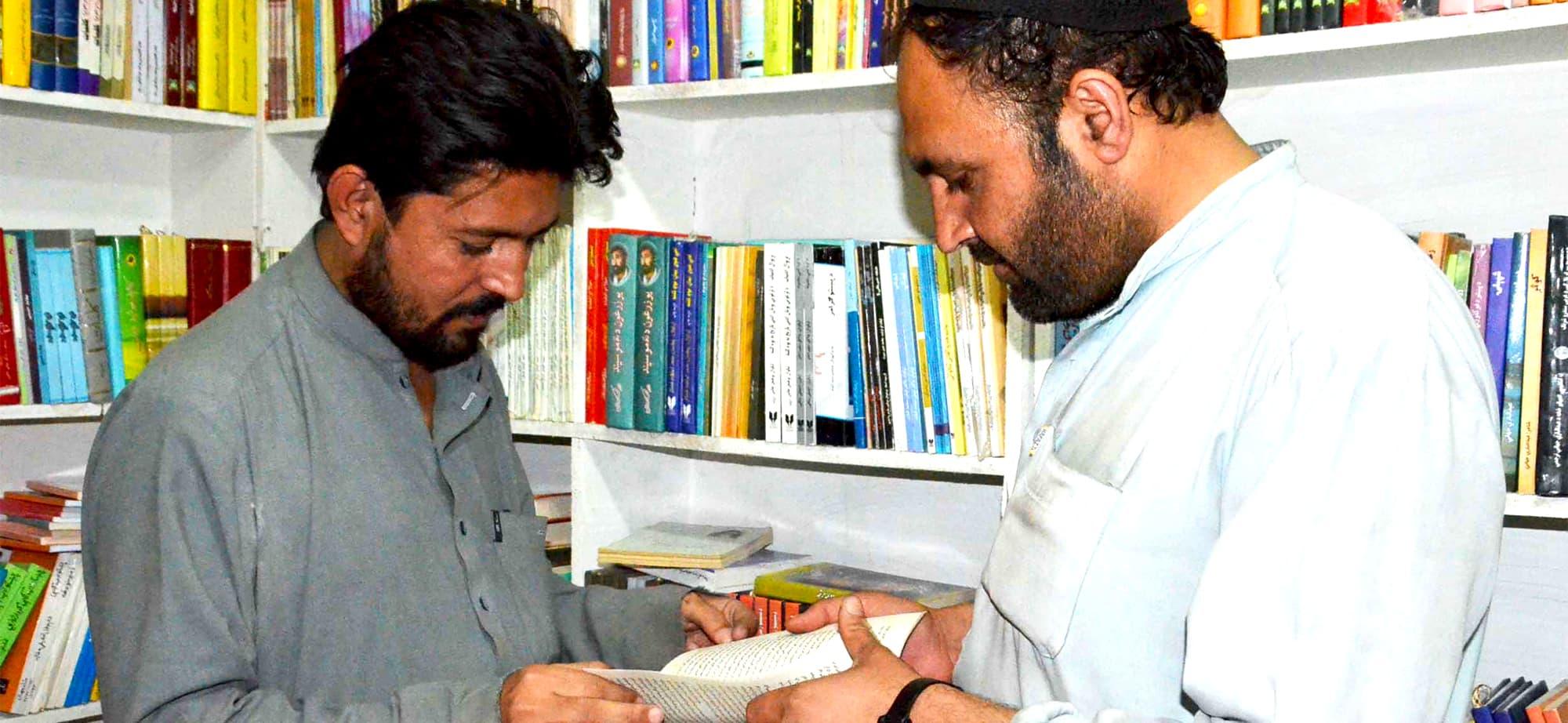 Baz Khan with a customer