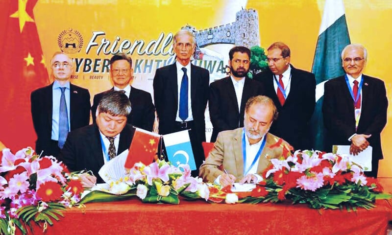 Beijing: KP Local Government Secretary Syed Jamal Uddin Shah and a Chinese official are signing five memoranda of understanding for development projects on Monday.—APP