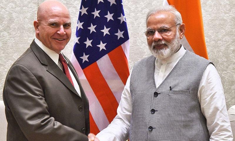 US Lt. General H.R McMaster shakes hands with Indian Prime Minister Narendra Modi in New Delhi. ─AFP