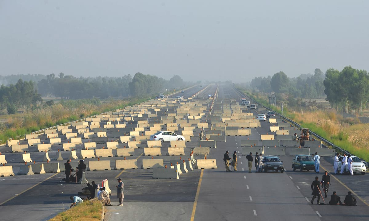 Roadblocks set up on the motorway to block a protest by Imran Khan over the Panama Leaks   AFP