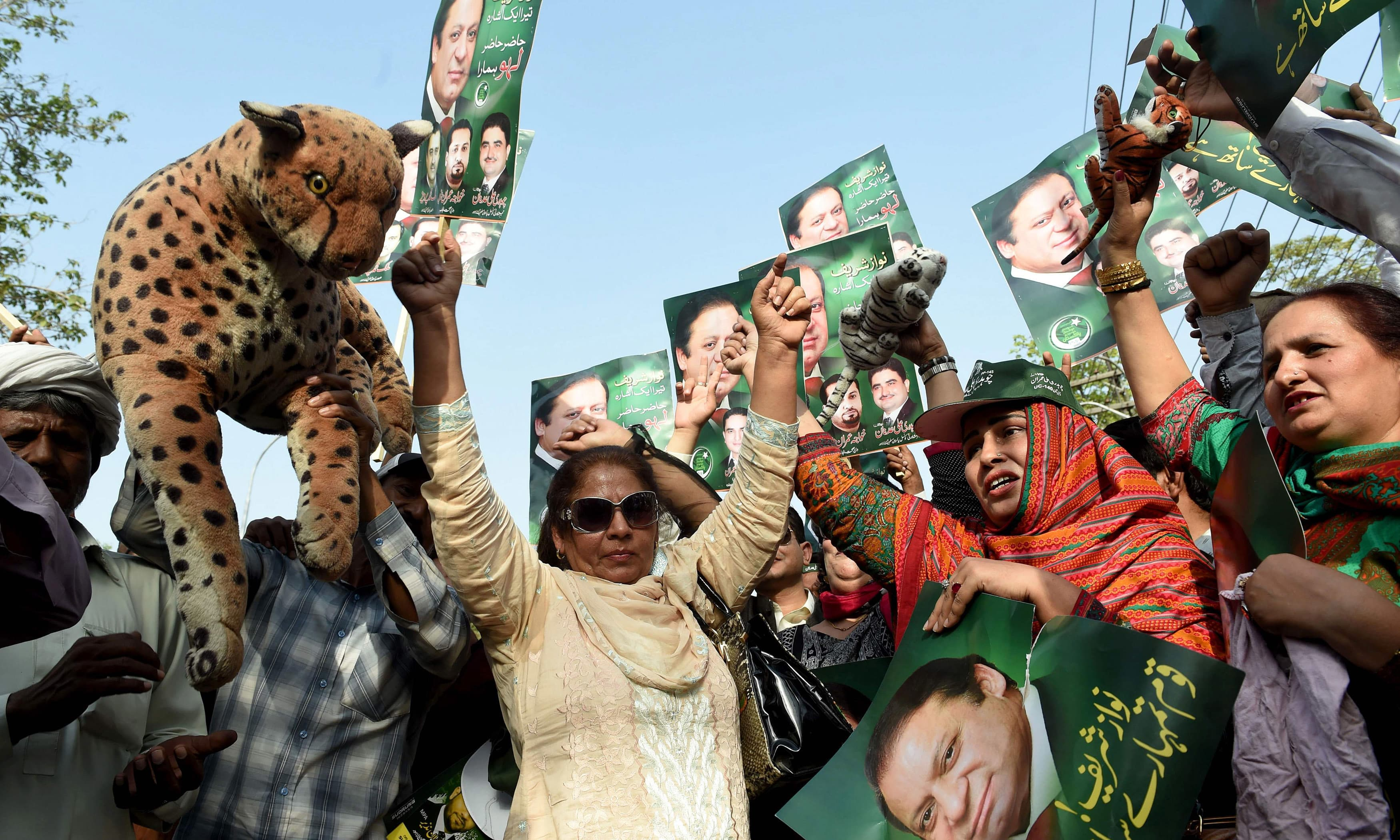 Sweets were distributed as party workers chanted slogans in support of PM Nawaz Sharif. ─AFP
