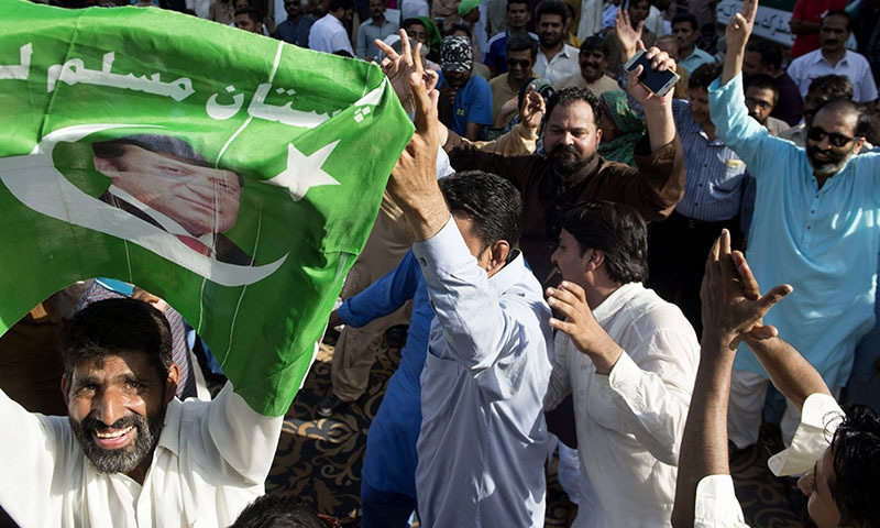 Supporters of the ruling party PML-N dance after a Supreme Court verdict. ─AFP