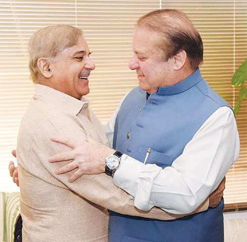 A jubilant Nawaz Sharif hugs brother Shahbaz Sharif after the announcement of the Panama Papers case verdict on Thursday. —Online