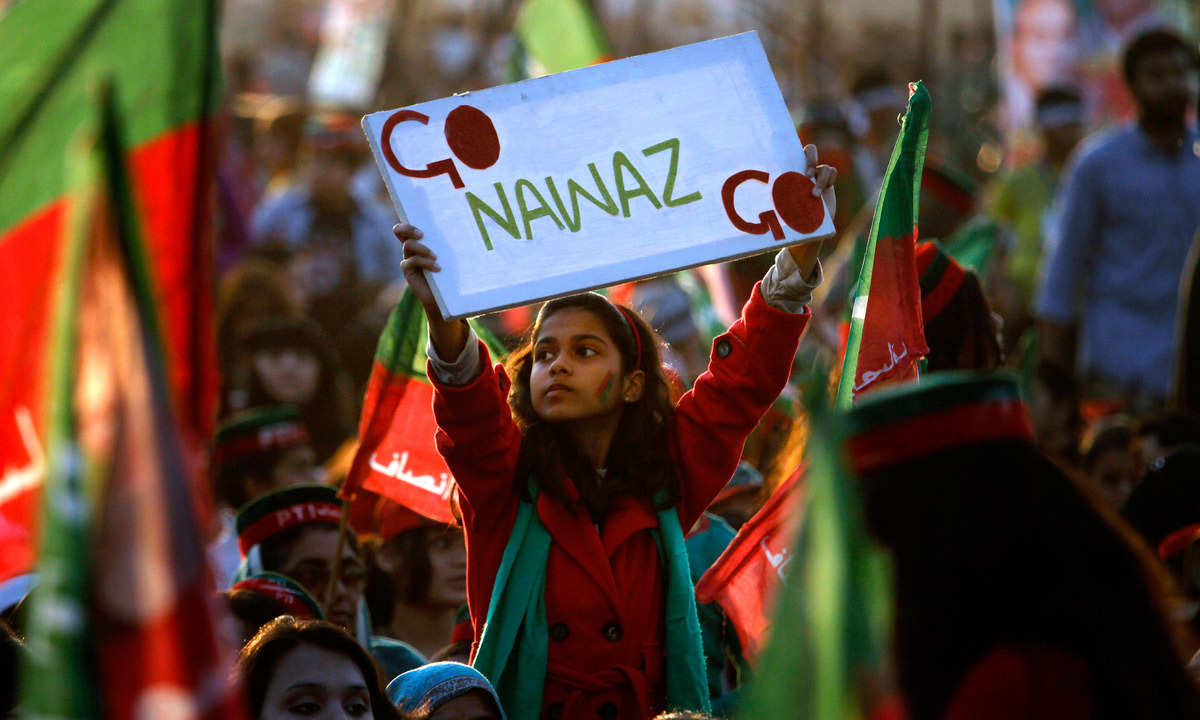 A young supporter raises a placard during an anti-government rally in Islamabad in November 2014 |  AP