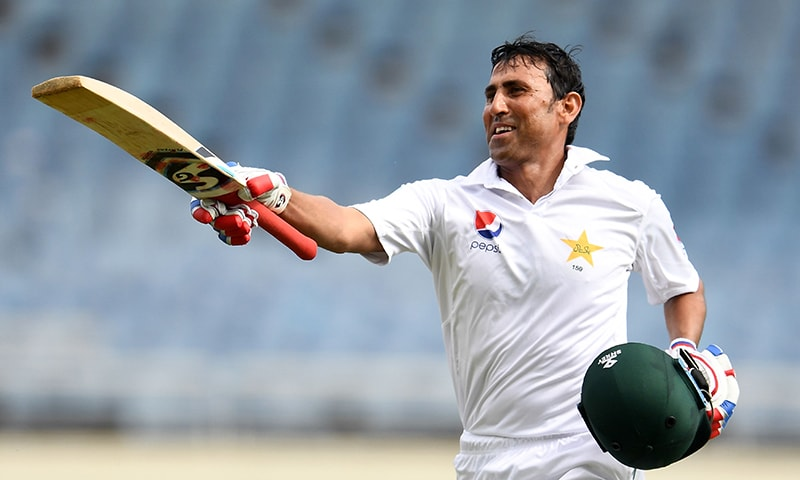 Younis Khan celebrates after reaching his 10,000th run in Test matches, on day three of the first Test match between West Indies and Pakistan at the Sabina Park in Kingston, Jamaica, on April 23.— AFP