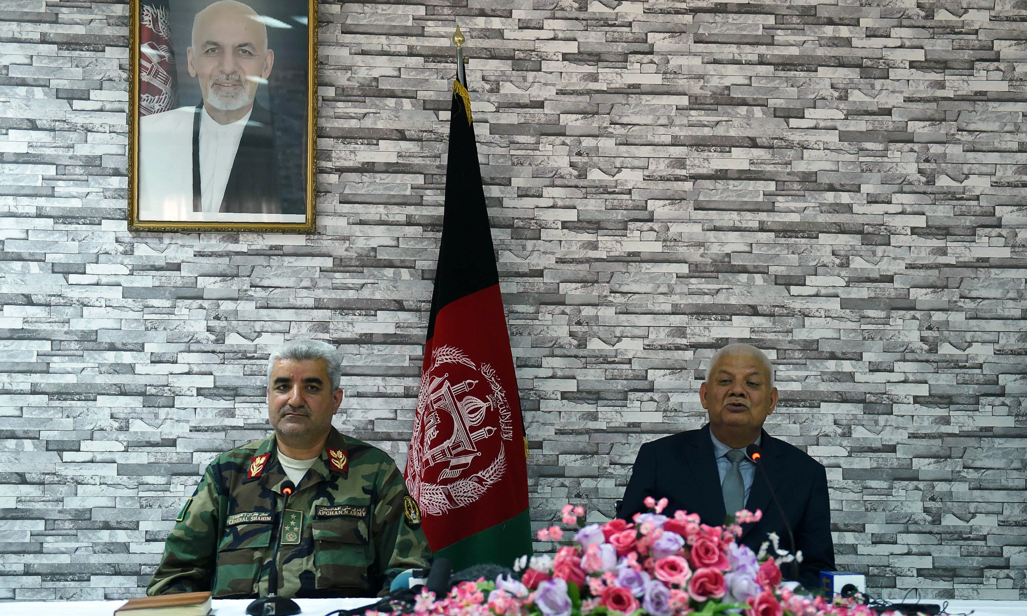 Outgoing Afghan defence minister Abdullah Habibi and army chief Qadam Shah Shaheem attend a press conference at the Ministry of Defence in Kabul. —AFP