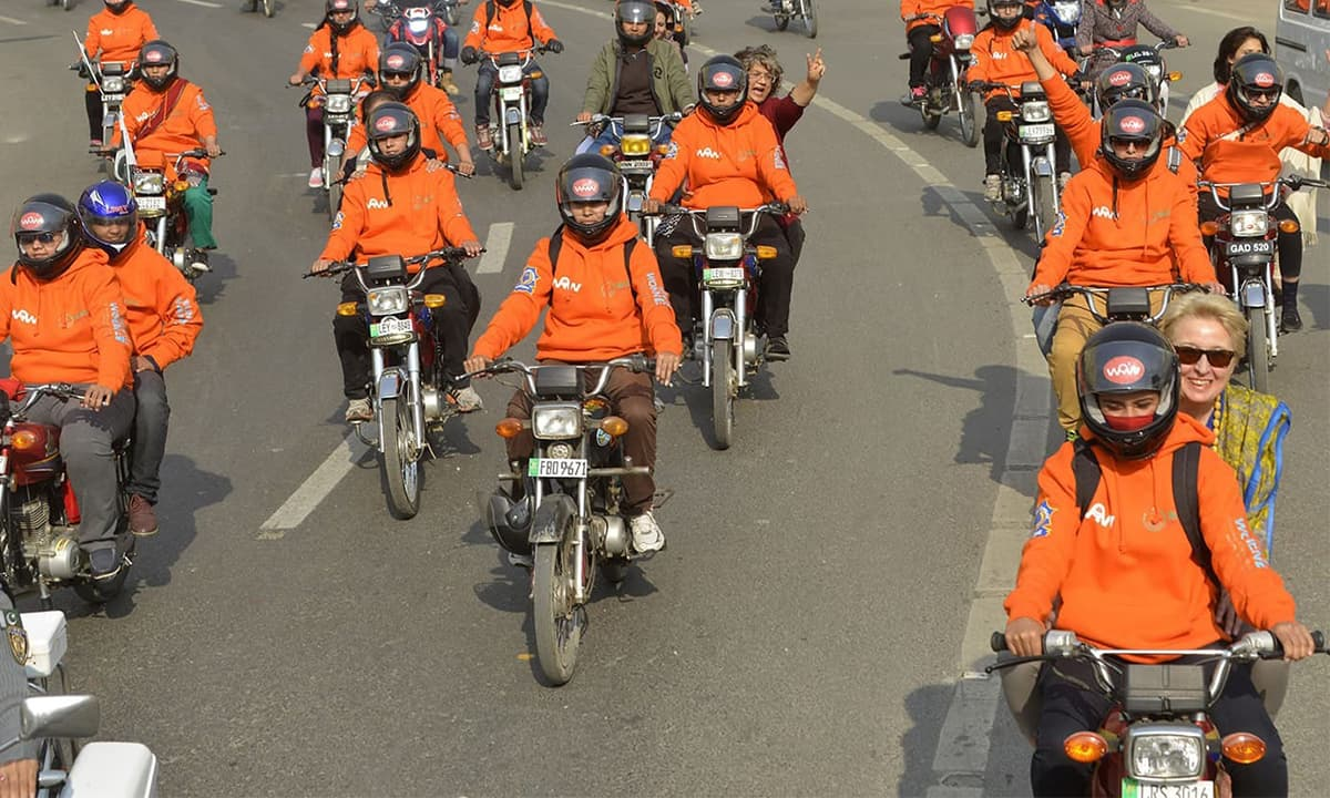 Over 100 female motorcyclists ride through Lahore at a rally launching the Women on Wheels campaign in July 2016 | AFP