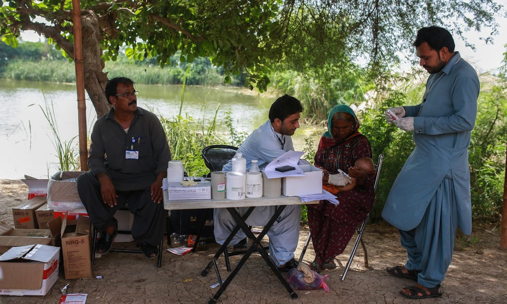 A MSF health officer performs a check up at a mobile clinic at Sikandarabad in Balochistan.—Sara Farid