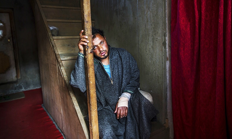 Kashmiri man Farooq Ahmed Dar, takes a break in the middle to talking to the Associated Press.—AP