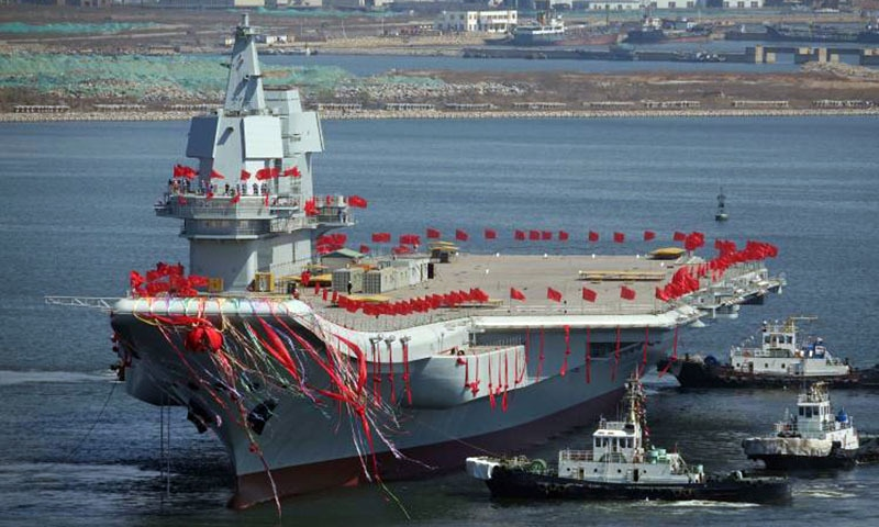 China's first domestically built aircraft carrier is seen during its launching ceremony.─Reuters