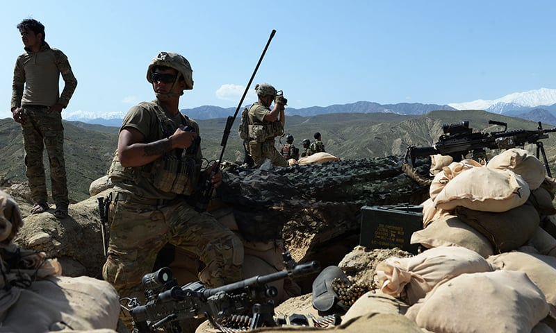 US soldiers take up positions during an ongoing an operation against IS militants. -AFP