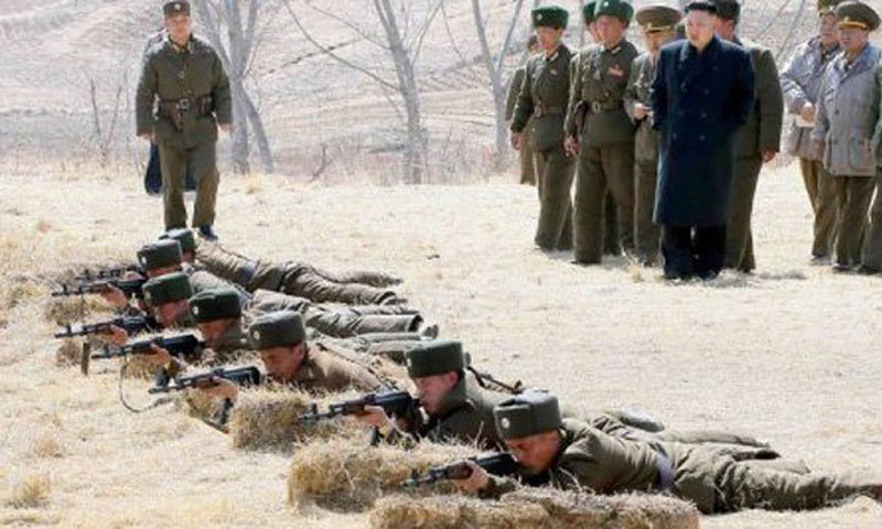 N. Korea stages large-scale artillery drill as US submarine docks in South