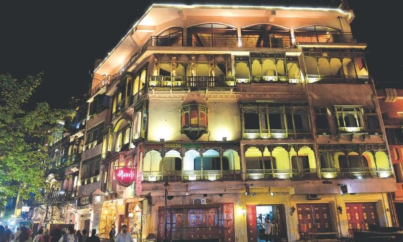 Old properties in Heera Mandi have been renovated and reused as restaurants (top) and other shops. Some others are up for sale (below). In the few brothels that have survived (left and bottom), much of the activity happens under the shadows