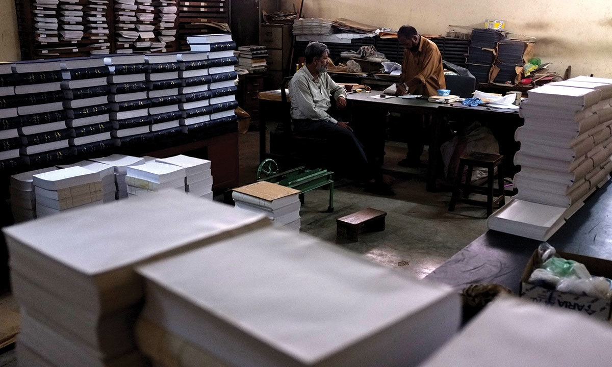 Workers bind dictionaries at the Urdu Dictionary Board in Karachi | Arif Mahmood, White Star