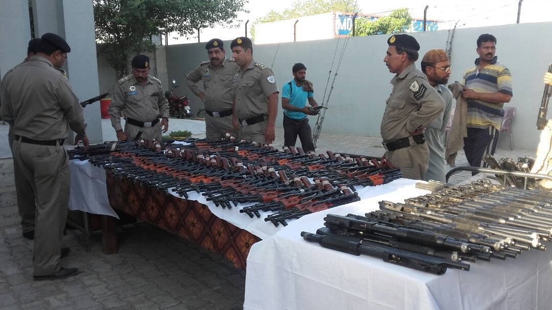 The cache of weapons recovered from the car are displayed. — DawnNews