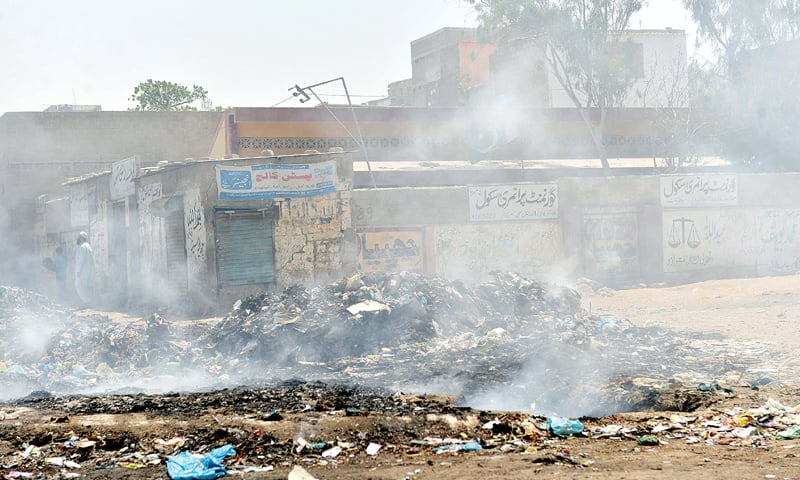 GARBAGE being burnt in the open in a city locality.—White Star