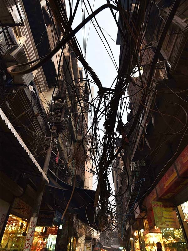 A tangled web of electricity cables in a street in Peshawar | Abdul Majeed Goraya, White Star