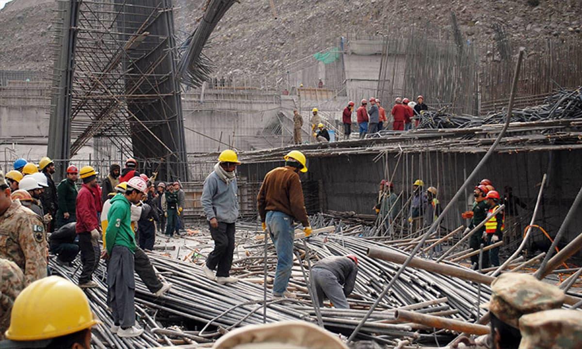 Pakistani and Chinese engineers at Neelum-Jhelum hydropower project   AFP