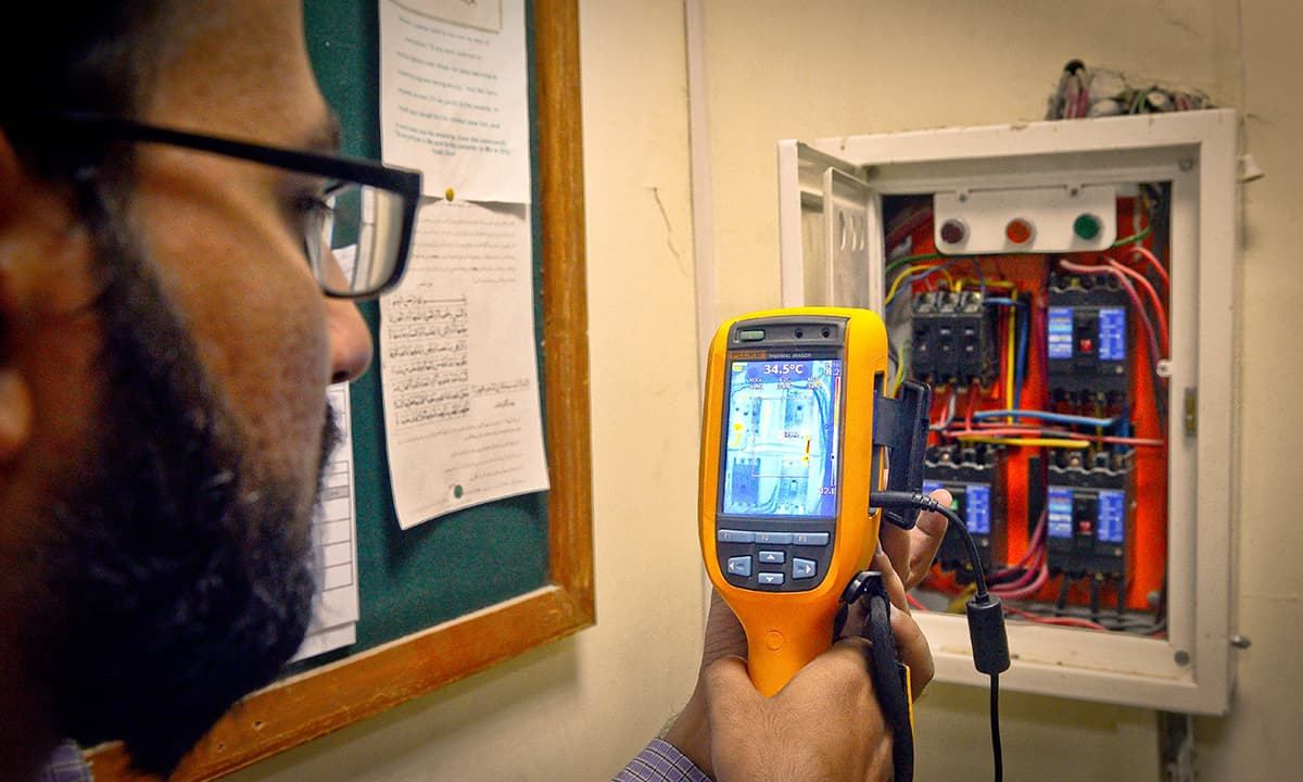 A technician monitors the power load during installation of solar panels   Fahim Siddiqui, White Star