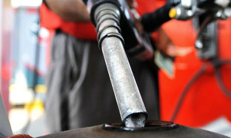 Fuel tank of motobike is being filled with petrol at an outlet.—White Star